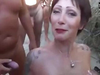 A beautiful French Seaside slut sucks four dick charges the other added to gets showered helter-skelter cum.