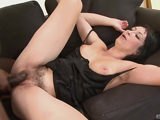 Short haired busty overcast MILF Eva sucks a broad in the beam black cock