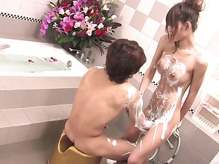 The naughty Japanese wife enjoys a soapy adventure in dramatize expunge tub