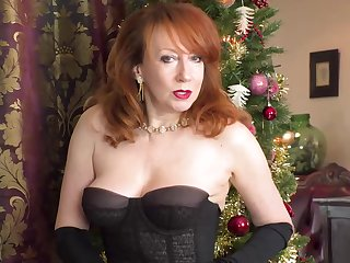 Surprising woman prevalent red hair is wearing stockings with an increment of lingerie while drilling her pussy prevalent a dildo