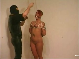 Slave girl Lindsey is dangling on someone's skin ceiling via her slutty indiscretion added to tied tits.
